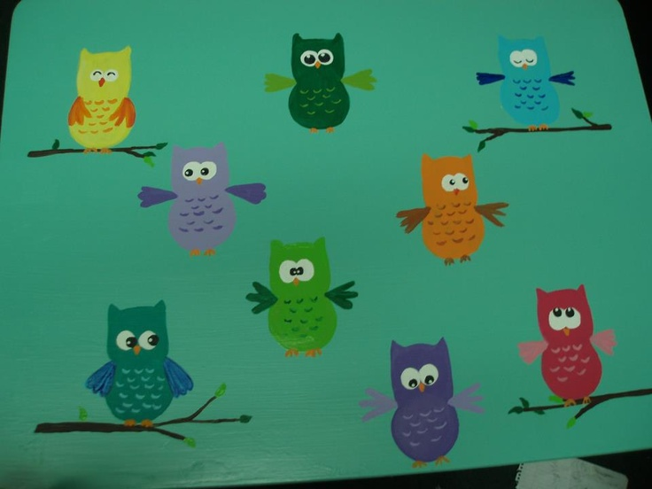 another old school desk with colorfull hootie owls lol