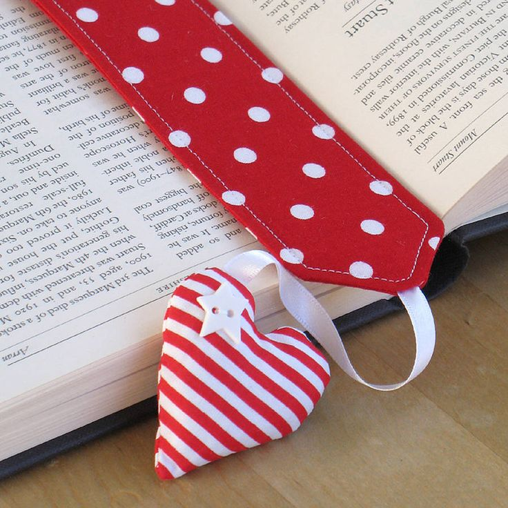 Pretty bookmarks with a twist - enjoy a truly relaxing read surrounded with the scent of lavender.These fabric bookmarks have little hearts filled with dried lavender from Provence dangling from satin ribbon to help keep your place. You can choose from red hearts, red dots/stripes, strawberries or pink/turquoise polka dots. Bookmarks are delivered attached to a printed card and sealed in a clear display bag.Each bookmark measures 17.5cm x 5cm