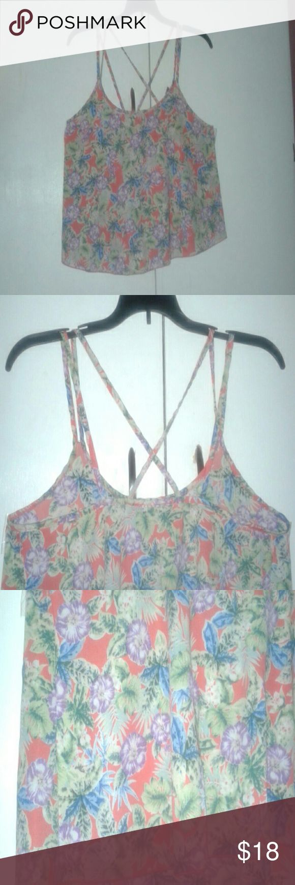 A orange floral blouse A orange blouse with tropical flower details and a beautiful strappy back. Tops Blouses