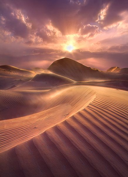 Breathtaking sand dune desert during sunset hour... if you look closely the wind blows the sand dust around... must be tough with the heat to take this picture :)