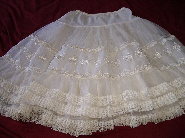 I wore one like this...nylon petticoat.  they were always scratchy and uncomfortable, but they made your skirt puff out so nicely!
