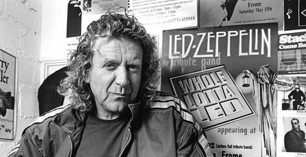 Robert Plant posing in front of a Led Zeppelin tribute band poster before a gig with Priory Of Brion Cheese & Grain, Frome Somerset UK May 20, 2000