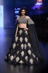 Black and Gold Floral Embroidered Cold Shoulder Cape and Lehenga Set  #Lakmefashionweek2016 #sva #prachidesai #showstopper #beauty #astonishing #showstopperoutfit #lehenga #embellished #luxurious #elegance #straightofftherunway #perniaspopupshop #happyshopping