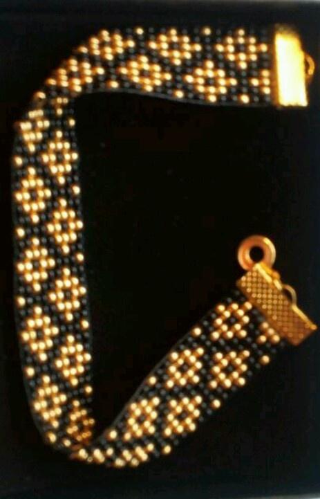 Bead loomed. 9 beads.