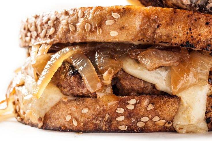 A classic turkey patty melt recipe, with caramelized onions and Swiss-style cheese on griddle-toasted rye bread.