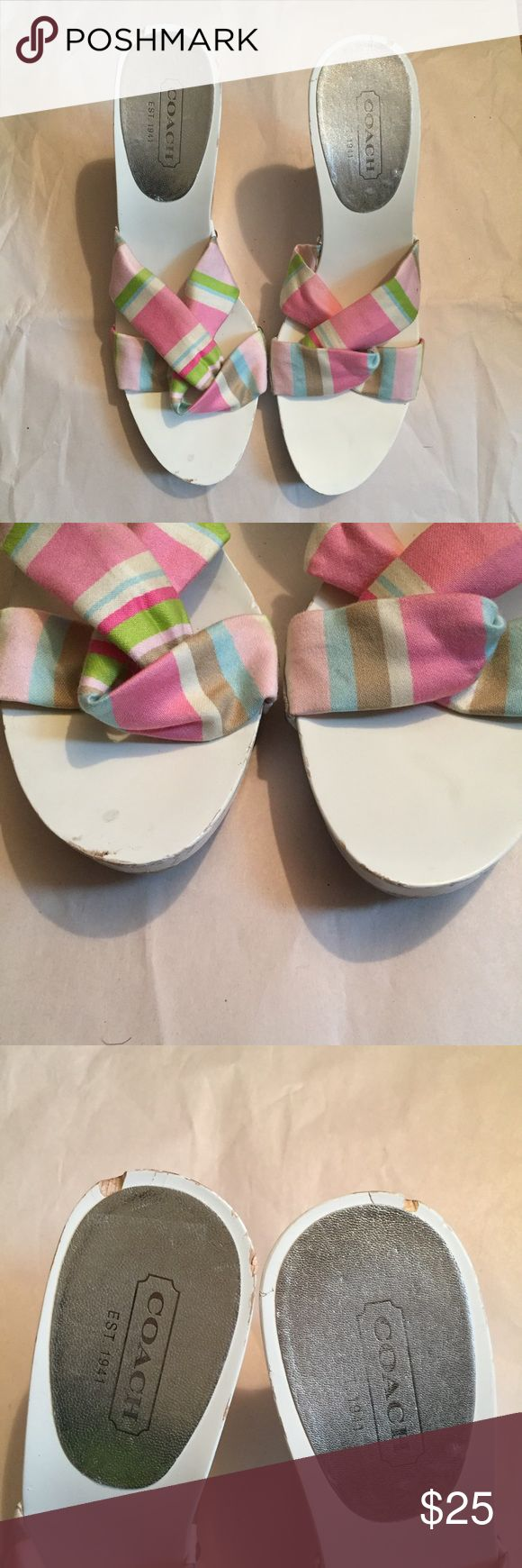 COACH Lina Printed Stripe Wedge Sz 8.5 Authentic Coach Lina Printed Stripe. Pink multi color strap with a white wedge. (Style A0022) Wedge is wood, and there are some nicks as shown in pictures . Really cute sandal for summer . Comes with box. Coach Shoes Wedges