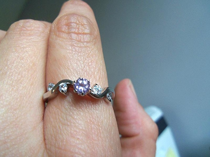 A #Diamond #Candle #ring featuring five small stones, four clear and one pink, on a simple yet different #silver band. Would you buy this ring if you saw it at a #jewelry store? www.diamondcandles.com