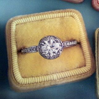 vintage engagement ring -- I don't even like the diamonds on the band...just the main one is gorgeous. I love how it looks beat up and not perfect.
