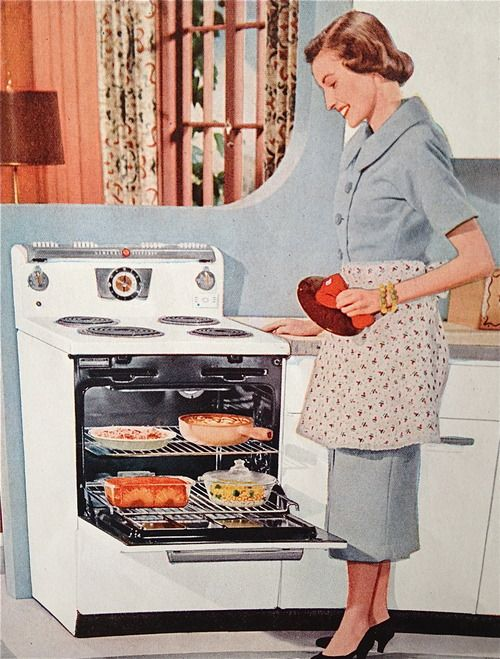 Mom & her new General Electric oven....holds TWICE the meat that the last one did...and even cooks it well enough to kill the bacteria!!   1955