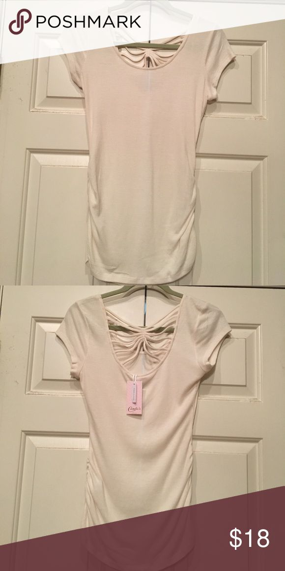 Cream short sleeve top Cream shimmer short sleeve top. Gathers from waist down. Back is accented with straps crossing the upper back. Very different. NWT Candie's Tops Tees - Short Sleeve