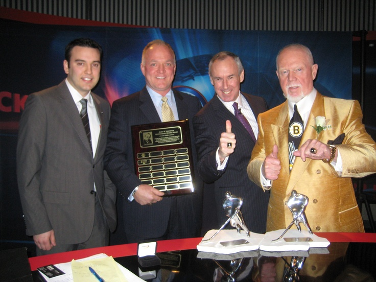 PHPA Executive Director Larry Landon, and PHPA Director of Communications and Business Development Darryl Dionne present Ron MacLean and Don Cherry with the 2009 PHPA Curt Leichner Distinguished Member Award on the set of Coach's Corner