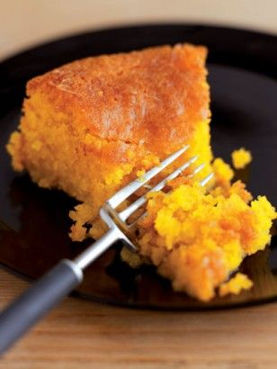LEMON POLENTA CAKE - This cake is a sort of Anglo-Italian amalgam. The flat, plain disc is reminiscent of the confections that sit geometrically arranged in patisserie windows in Italy; the sharp, syrupy sogginess borrows from the classic English teatime favourite, the lemon drizzle cake. It is a good marriage...