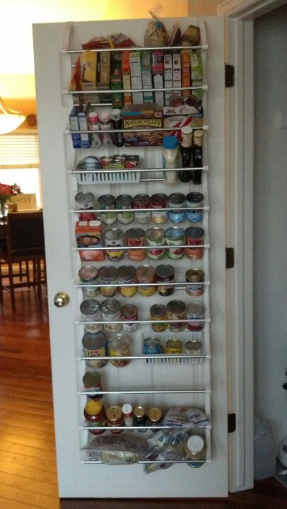 Using an over the door shoe rack I turned our entry closet door into a make shift pantry.