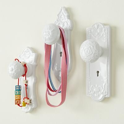 doornobs - buy some at the flea market and paint them a solid color for a hanger solution for ruth's headbands and such - cute!