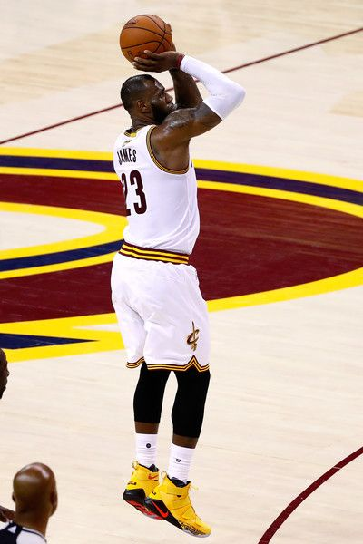 LeBron James Photos Photos - LeBron James #23 of the Cleveland Cavaliers shoots in the second quarter against the Golden State Warriors in Game 4 of the 2017 NBA Finals at Quicken Loans Arena on June 9, 2017 in Cleveland, Ohio. NOTE TO USER: User expressly acknowledges and agrees that, by downloading and or using this photograph, User is consenting to the terms and conditions of the Getty Images License Agreement. - 2017 NBA Finals - Game Four