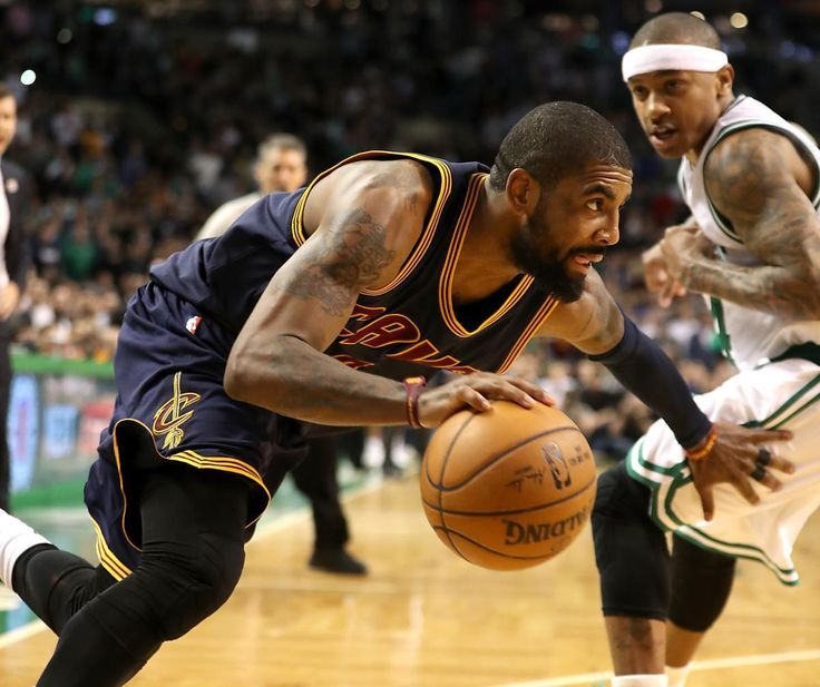 Boston MA 3/1/17 Cleveland Cavaliers Kyrie Irving drives past Boston Celtics Isaiah Thomas during fourth quarter action at TD Garden. (Photo by Matthew J. Lee/Globe staff) topic: Celtics pics reporter: Adam Himmelsbach