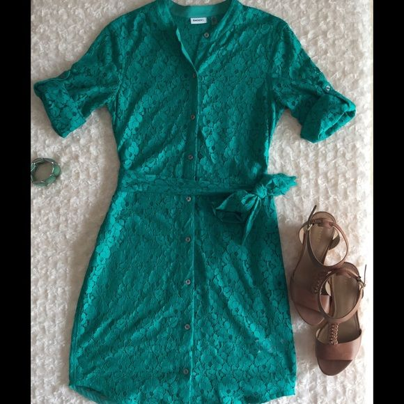 Teal Lace shirt dress with roll up sleeves This shirt dress is great for summer! Teal lace paired with the structure of a shirt dress makes this casual dress a must have! This dress is see through however so it must be paired with a slip, teal, black white or nude any color slip will work!. pair with wedges of flats for effortless style. DKNY Dresses