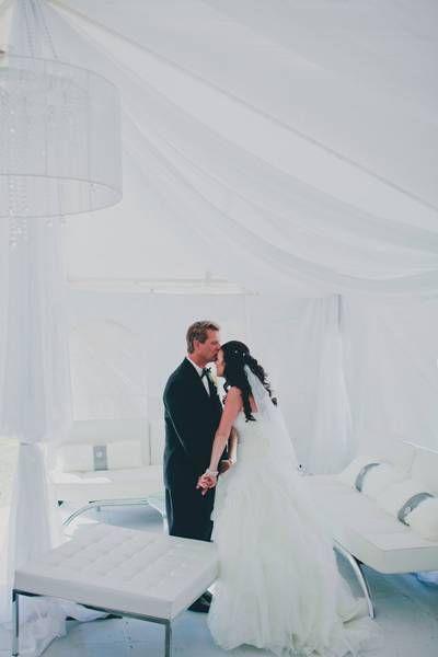 It's Love Magazine Feature . Joy & Scott Part 2 . Real wedding by Divine Weddings & Events . Black and white wedding with draped lounge area.  http://weddingsinwinnipeg.ca/inspirationroom.php?post_id=2381