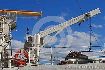 Contemporary lifting device on the upper deck of the ship