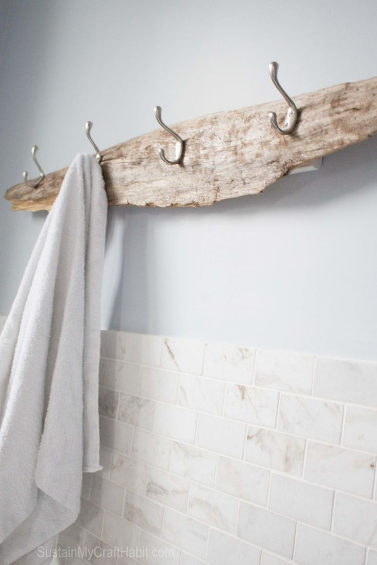 Driftwood beachy towel rack. A beautiful piece of driftwood found on the beach is upcycled with useful hooks for towels. Great rustic bathroom decor. http://SustainMyCraftHabit.com