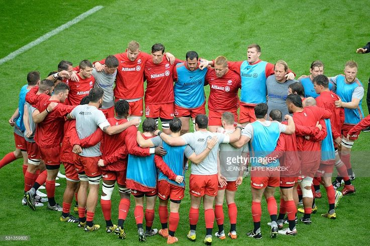 Saracens' players stand together ahead of the European Rugby Champions Cup match beetween Racing Metro 92 and Saracens FC at the Parc Olympique Lyonnais stadium in D��cines-Charpieu, eastern France, on May 14, 2016.