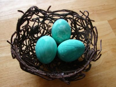 Yarn nest and painted eggs. My kids will love doing this. 14 unique DIY Easter egg decorating ideas from Parenting.