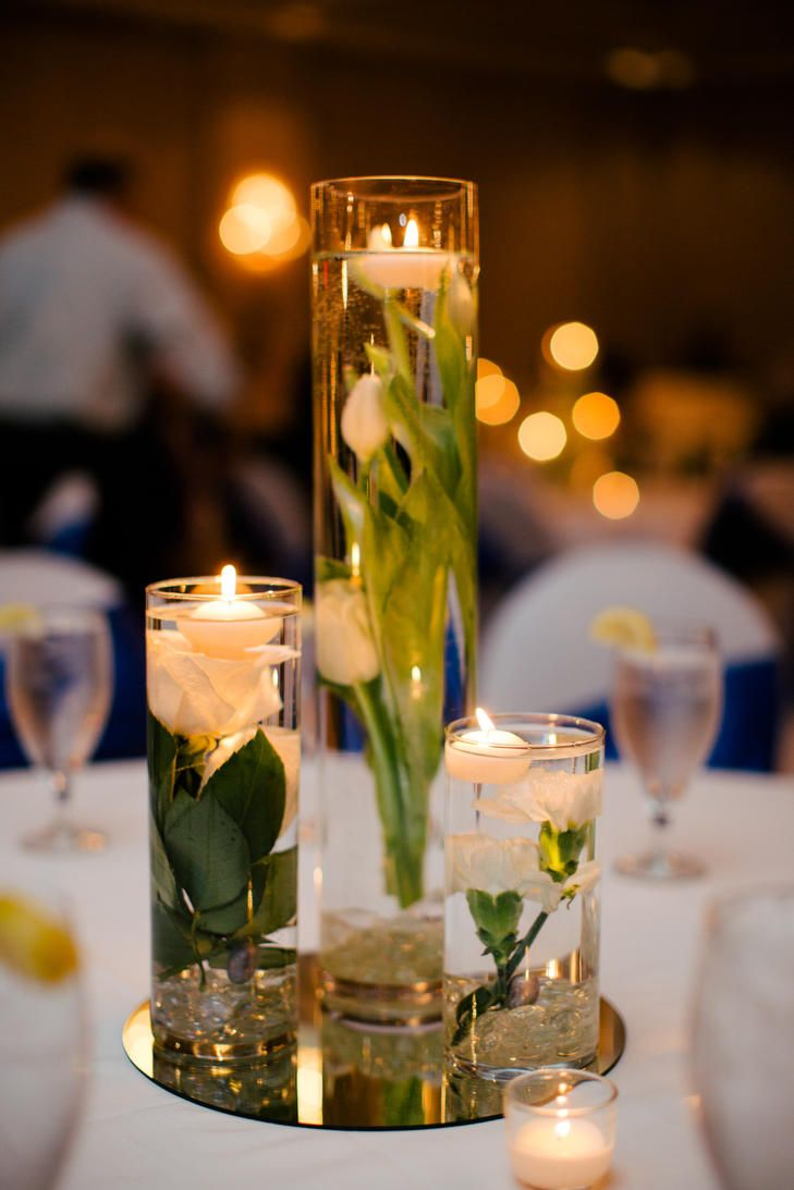 Submerged flower centerpieces with floating candles