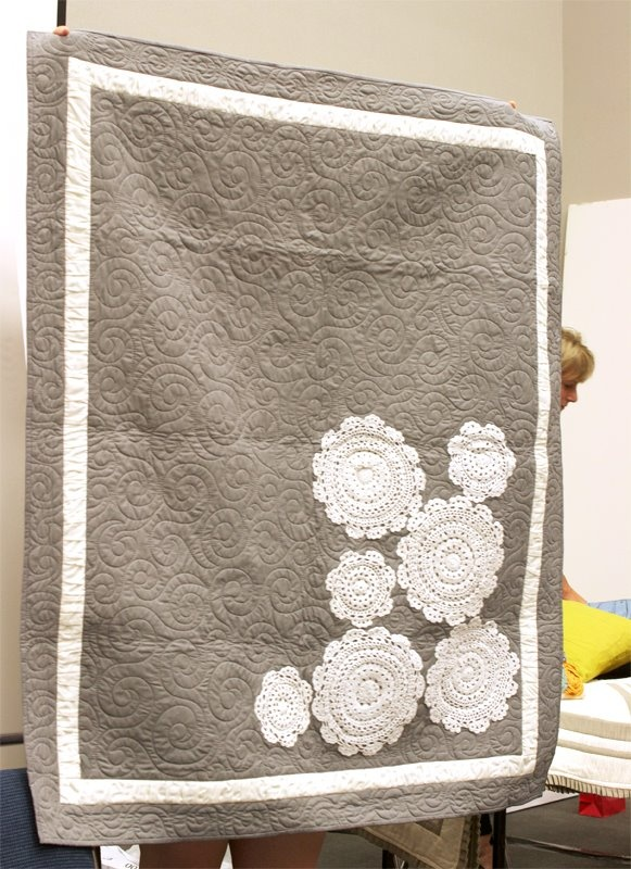 And have you heard about Vanessa Christenson's new book? It's all about sewing for the busy mom.  She also shows you how to use a lot of texture rather than prints for a sophisticated and clean appeal. Here is an example she of a super cute quilt she made using traditional doilies.