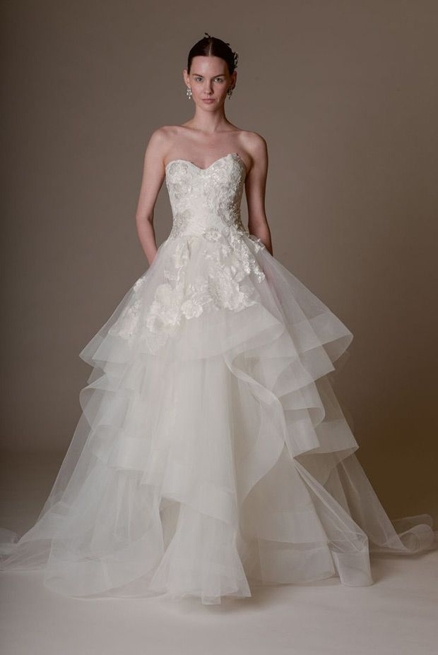 Strapless tulle ball gown wedding dress with a blue crystal bodice and floral garland details, | www.onefabday.com