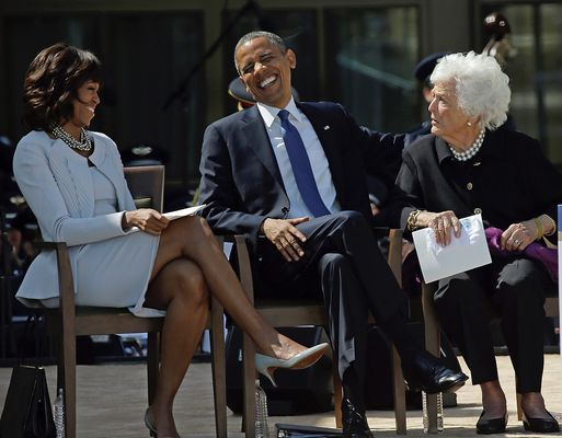 President Barack Obama laughs as he sits between his wife, First Lady Michelle Obama and former First Lady Barbara Bush after his speech during the dedication of the George W. Bush Presidential Center.  --April 25, 2013