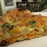 Sweet potato and cheese frittata - I added portabella mushrooms that I sauted for about 5 minutes before I placed them on top of the onions.  It took about 45 minutes to cook instead of the suggested 25.
