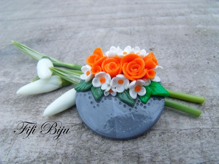 Fimo brooch with white and orange flowers