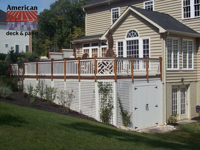 Baltimore, MD - Storage Shed. Very attractive wood and cedar deck with lattice skirt and double doors for storage area under deck.