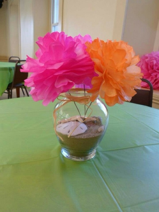 Luau party centerpieces. The flowers are made from coffee filters and then spray painted to match party colors.