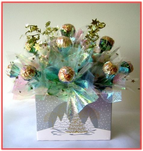 """This """"frosty"""" Candy Bouquet is made of 13pcs Ferrero Roche chocolates, enhanced with colourful cellophane, nested in a Xmas themed gift box."""