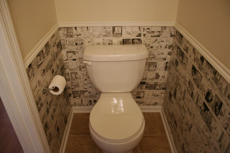 Small bathroom with walls decoupaged by comic strips the person who created this used the far - Bathrooms for all tastes ...