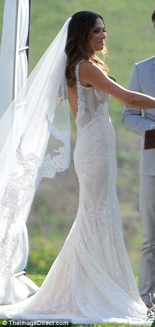 'As soon as she tried this one on, she instantly lit up': The brunette bride bared her bac...