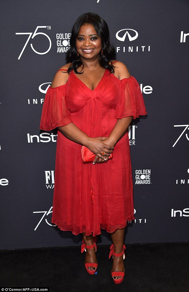 Glorious: Hidden Figures star Octavia Spencer showed off her cleavage in a stunning cold shoulder red chiffon dress that she paired with matching sandal heels with bows at the ankle