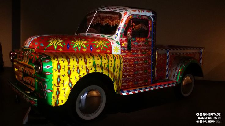 A resplendent Dodge pick-up Van of 1952 decorated with beautiful stickers and tapes to represent the popular street art which has its origins in Pakistan!