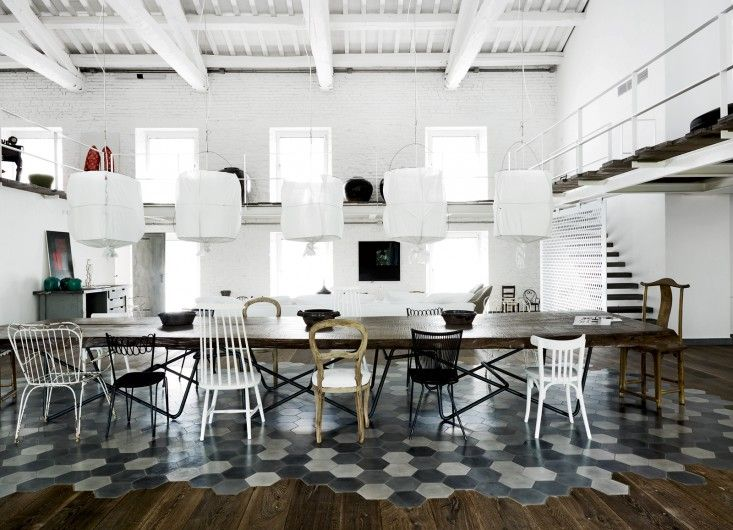 A loft designed by Paola Navone with her own hexagonal tile design that sits atop the wooden floor like a carpet.
