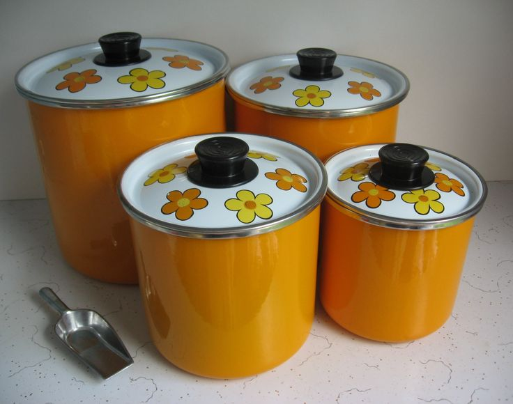 My flower-power super-bright orange enamelware canisters.
