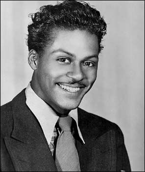 Mr. Chuck Berry in a publicity photo from the 50's....can be used for your dolls face??