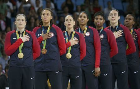 2016 Rio Olympics - Basketball - Final - Women's Gold Medal Game USA v Spain - Carioca Arena 1 - Rio de Janeiro, Brazil - 20/8/2016.  Lindsay Whalen, Seimone Augustus, Sue Bird, Maya Moore, Angel McCoughtry, Breanna Stewart and Tamika Catchings of USA (L to R) stand for the playing of the U.S. National Anthem during the medal presentation ceremony for the women's basketball top finishers.    REUTERS/Shannon Stapleton