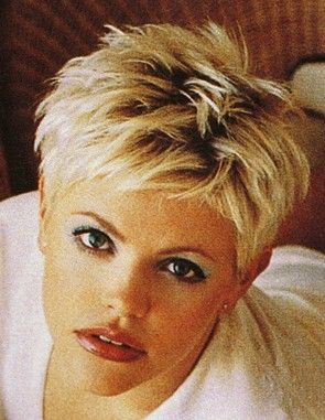 Natalie Maines...or add more hair and less makeup and it's Tra!!