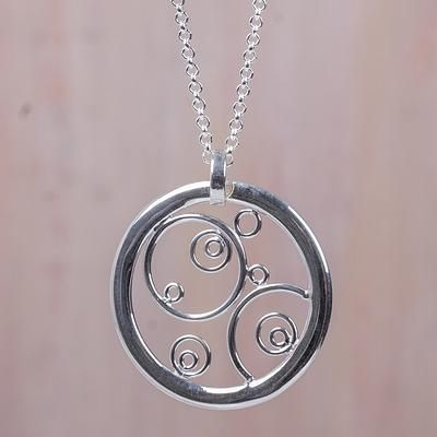 Sterling silver pendant necklace, 'Magical Circles' - Artisan Crafted Circular Sterling Silver Pendant Necklace