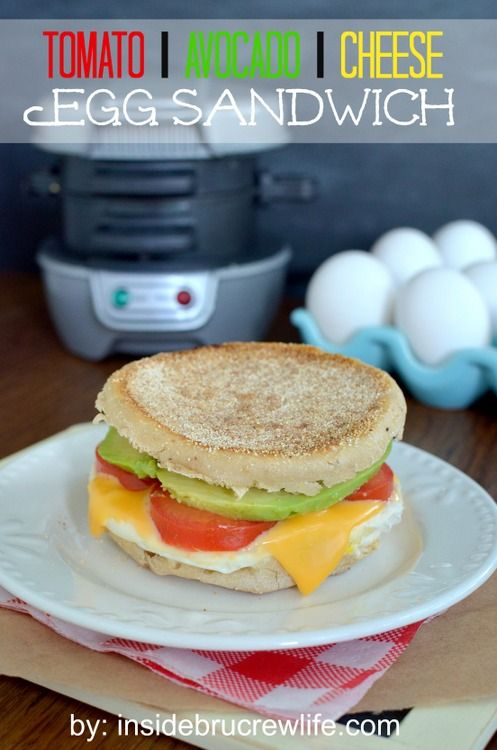Tomato Avocado Egg Sandwich - the traditional egg sandwich gets a twist from tomato, avocado, and cheese http://www.insidebrucrewlife.com