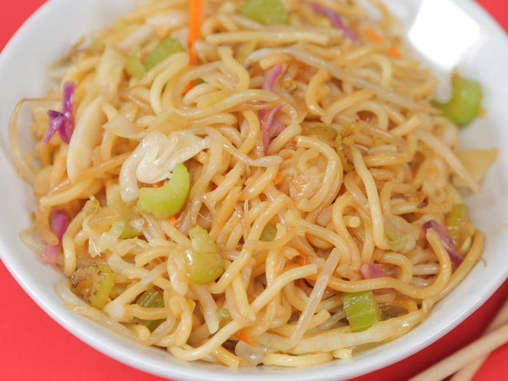 Copycat Panda Express Chow Mein | You can make this Panda Express menu favorite at home in less time than it'd take you to load in the car and hit the drive thru. Even better, you can customize our copycat chow mein easily by adding in any favorite veggies you have on hand. If you want to bulk this easy noodle dish into an entree, add your protein of choice—leftover chicken, shrimp, or a freshly fried egg would all make great additions (and they won't cost extra).