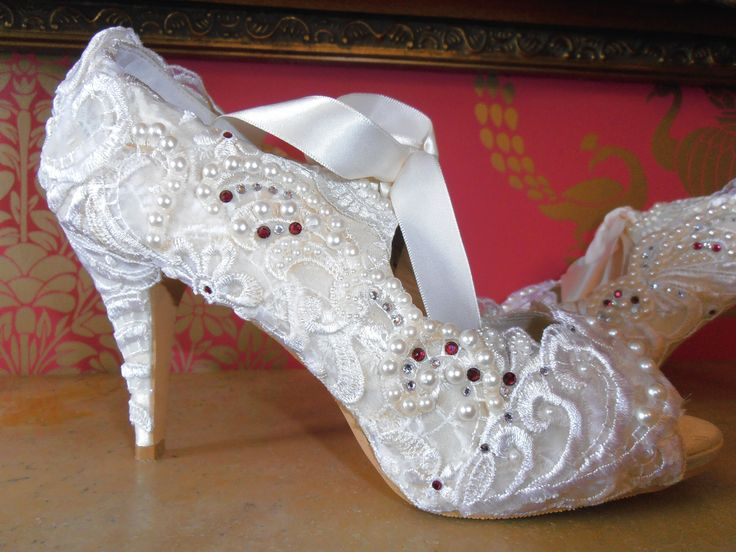Design 'REGALIA' - embellished with white lace, white embroidery, pearls and Swarovski elements and white satin ribbon ties.  Soft leather insoles - Nicky ROX Shoe Designs