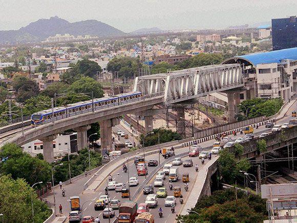 A Chennai Metro Rail train runs on the tracks between the Airport and Little…