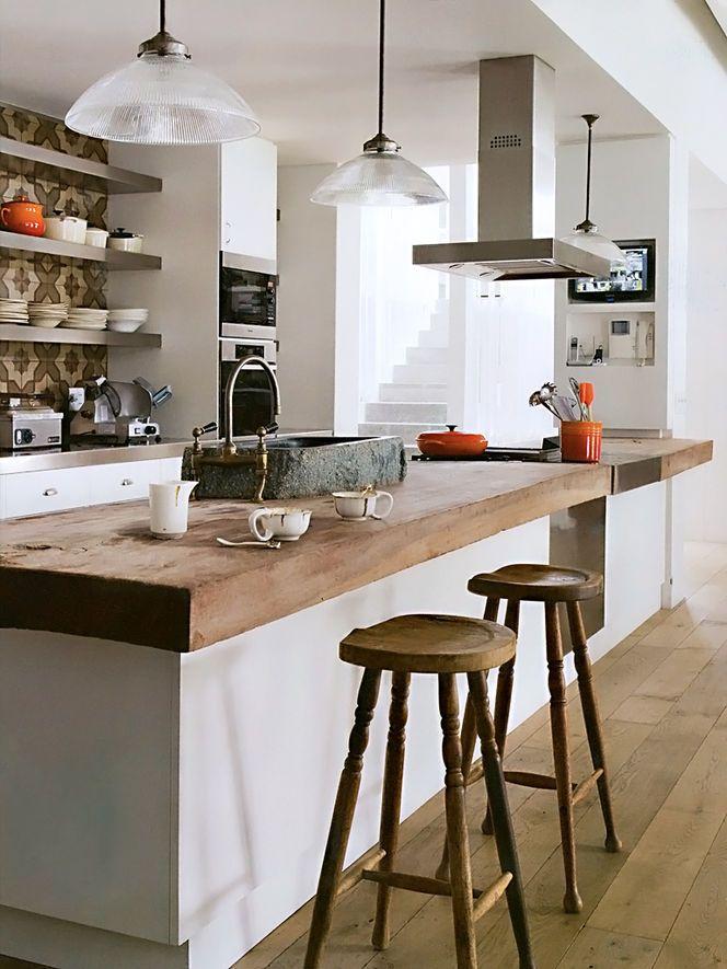 Kitchen - tile behind open steel shelving, rustic wood island Photo: Nicholas Matheus